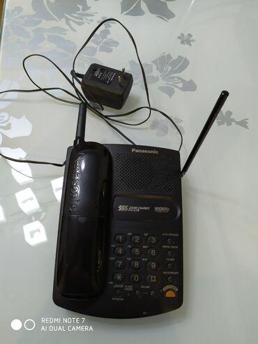 Радиотелефон в рабочем и в хор.сост. 1100с