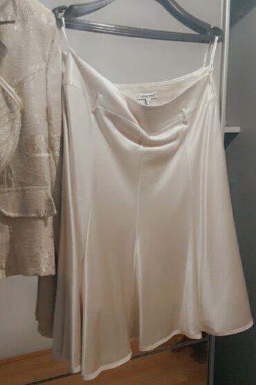 Suknja od satena. boje sampanjca40 vel. postavljenaItalijanska