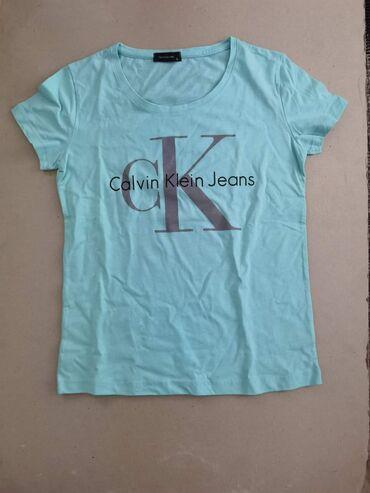 Ženske majice - Novo - Sivac: Calvin klein 1600din