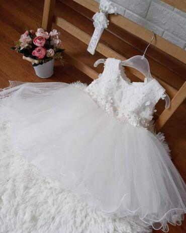 Prelepa bela haljinica sa duplom postavom i tri reda tila,izuzetno