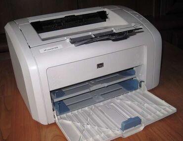 Отличный принтер HP LaserJet 1018. Работает отлично. Печатает чисто. К