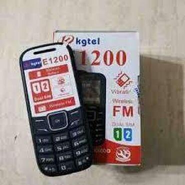 Debde olan E1200 kgtel markali iki nomreli telefondur,karopkasi,adapt
