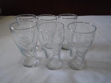 Komplet od šest novih coca cola čaša. Visina čaša je 14 cm a - Belgrade