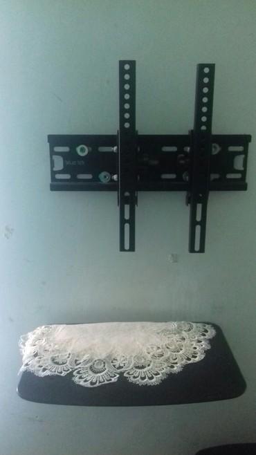 Bakı şəhərində Salam satilir televizor asilqani ve dvd krosnu yeri ikisi bir yerde