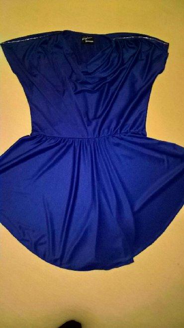 Ženska odeća   Svrljig: Tunika divne plave boje,sa cirkonima na ramenima. Veličina je 38,ali