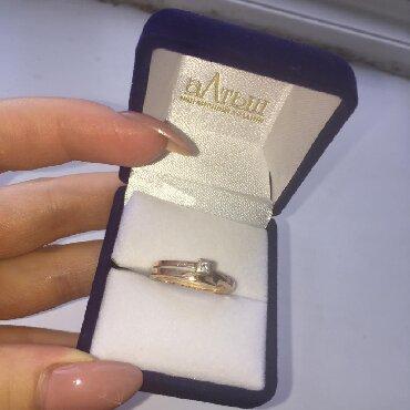 Продаю золотое кольцо с бриллиантом(со всеми документами)