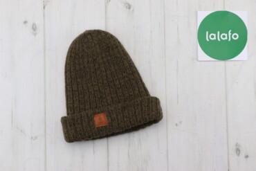 Жіноча в'язана шапка з натуральної шерсті   Довжина: 25 см Ширина: 17