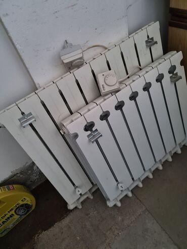 Radno odelo - Srbija: Prodajem aluminijumske radijatore sa CINI grejacem. Moze u kompletu
