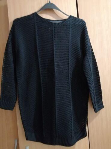 Tunika marke Esmara vel 40,boja je intenzivno crna.  Materijal je 50%p
