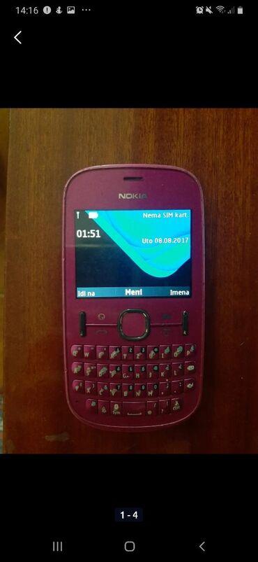 Nokia asha 210 - Srbija: Prodajem telefon Nokia Asha 201, pink boje, star nekoliko godina ali