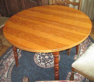 Trpezarijski sto na rasklapanje-drvoPrecnik 1.08m, razvucen 1.40m