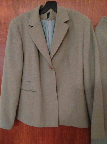 Komplet sako i suknja,kao nov ,zelenkaste boje. Obim grudi 101....... - Belgrade