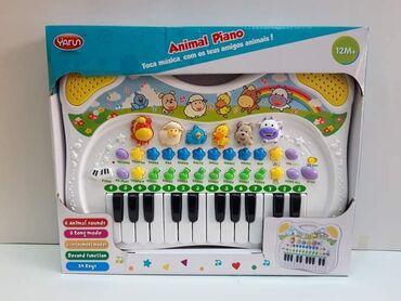 Muzički piano, svira, oponaša zvuke životinja 39*31 cm Cena 2600 din