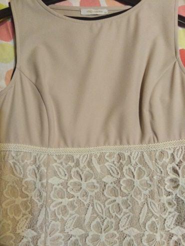 Krem haljinica. Ima elastina. Dužina 87cm - Sabac