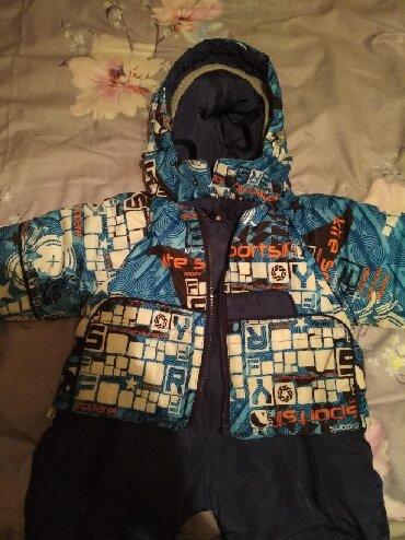 Продаю зимний комбинезончик на мальчика 2 года,одевали пару раз с