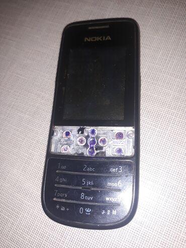 adaptr - Azərbaycan: Nokia telefon satılır. Adaptoru da var. İşləyir. Sadəcə korpusu