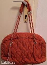 Odlicna torba. Boja prelepa narandzasta kao bundeva, nije drecava. Sve - Nis