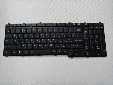 Klaviaturalar - Masazır: Toshiba nootbukunun klaviaturası. Təzədən seçilmir