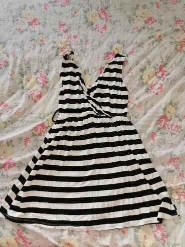 Letnja haljinica, najvise za plazu, jednom obucena. Bez kajisa