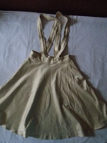 Svileni suknja - Srbija: Nova sa lica kao svilekasta suknja na tregere, do kolena. Materijal