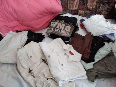 Dečija odeća i obuća - Despotovac: 4 pantalona 2 bermude1 sorc10 majca kratak rukav6 dug rukav 2
