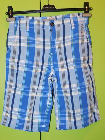 H&M plavi pamucni sorc do kolena i ispod zavisi od visine deteta