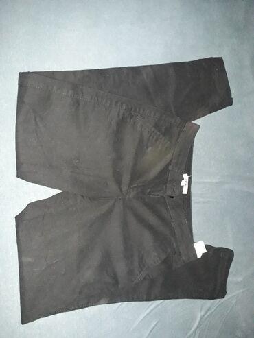 Personalni proizvodi - Irig: Crne pantalone kao nove