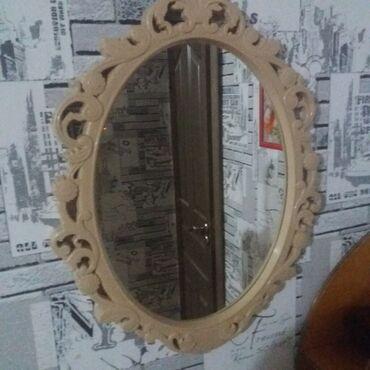Зеркало в пластмассовой оправе. Размер: 33х45 см