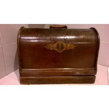 Παλιά ραπτομηχανή - the singer manfc. Co. Trade markΤο χερούλι της