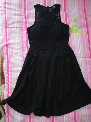 Haljine - Sremska Kamenica: Prodajem novu crnu haljinu sa etiketom S/M velicina. Duzina 87cm