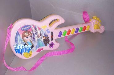 Podna lampa - Srbija: Frozen GITARA igračka za decuNa gitari se nalaze 8tastera čijim se