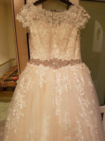 размер 44 платья в Кыргызстан: Свадебное платье. Цвет айвори.размер 44.46.привезли с России.модель