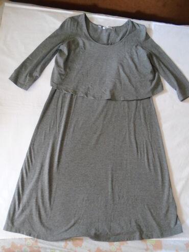Tegljiva, jednom obučena haljina visokog kvaliteta, neobičnog kroja