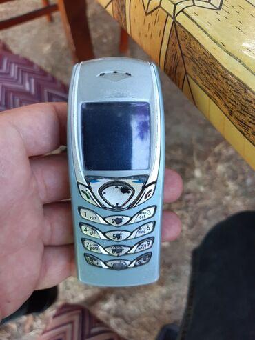 6100 - Azərbaycan: Nokia 6100.retro telefondu.normal veziyyetdedi.adaptri var