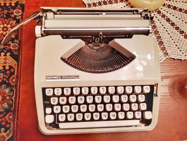 Pisaca masina - Beograd: Pisaća mašina - Hermes Baby, sa njenim original koferčićemKao nova