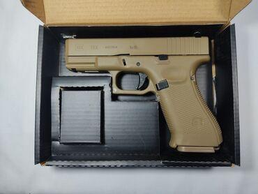 Пластиковый шифер - Кыргызстан: Страйкбольный пистолет от E&C Glock-19 gen 5,стреляет утяжеленным