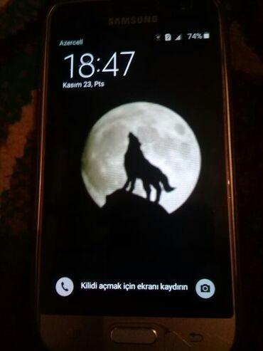 Б/у Samsung Galaxy J1 Оранжевый