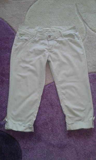 Ženska odeća   Kovilj: Zenske pantalone,ocuvane velicina L