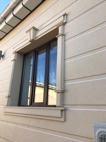 Элементы фасадного декора из пенополистирола с покрытием. Фигурная