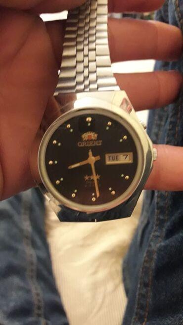 Qol saatları - Dübəndi: Gümüşü Kişi Qol saatları Orient