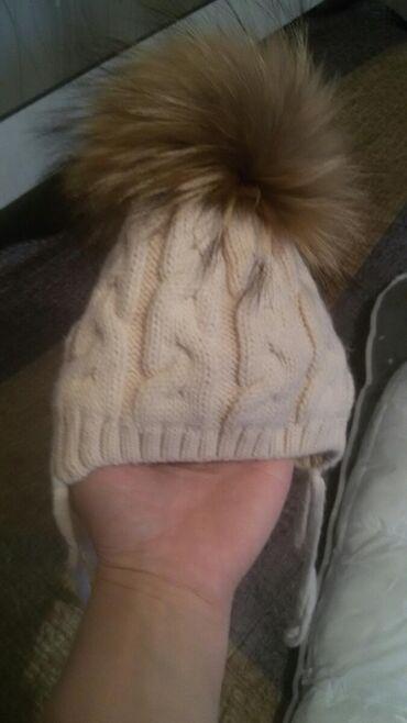 отдам детские вещи бесплатно в Кыргызстан: Продаи шапочку натуральный мех . Гипоалергенная размер 0-6 мес