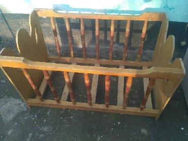 Маленькая кроватка из дерева. Длина 103см,ширина 61см, высота 60см