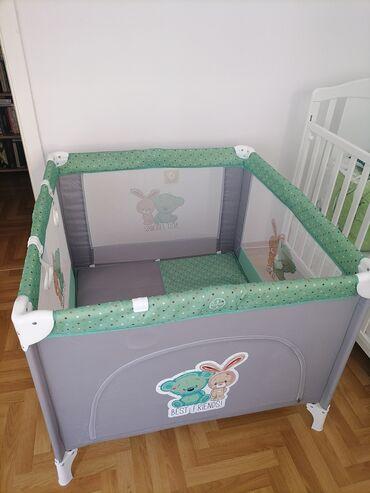 Ogradica za bebe, sivo zelena, u odlicnom stanju. Cena 6000dinara