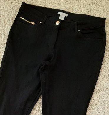 Pantalone sa na - Srbija: H i M uske zift crne sa elastinom pantalone. Klasični džepovi napred