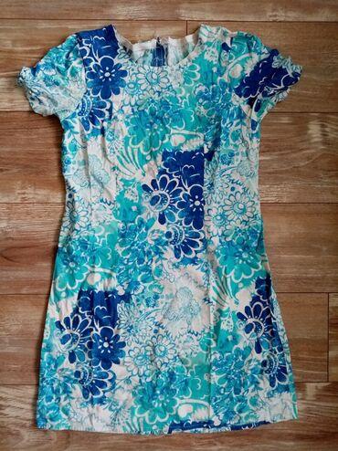 Strukirana haljina, kao nova kratkih rukava. Širina ramena 37 cm