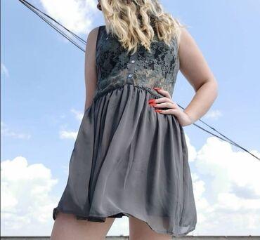 Odlicna haljina, za svaku priliku bez ostecenja.Moze da se stavi kais