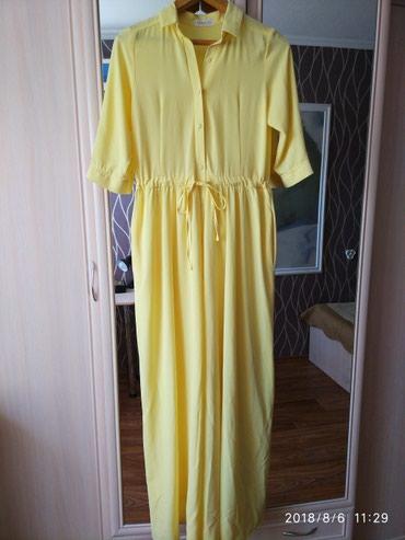 Очень удобное платье,на пуговицах размер 44-46,подходит беременным и