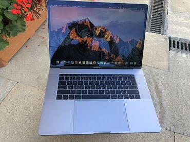 Teze istifade edilmeyib. Macbook pro touchbar Core i7 2020 ci ilde