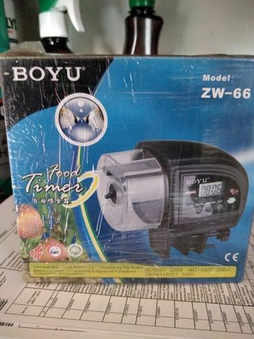 Автоматическая кормушка для рыб в аквариум.Новая. в Бишкек