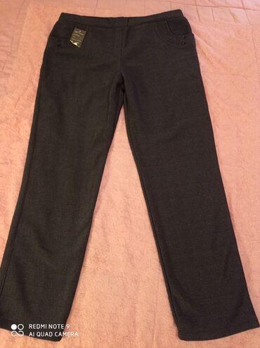 Отдам новые теплые женские брюки 58р. За 500с. Асанбай
